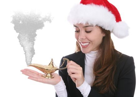 lamp: A pretty woman making Christmas wishes with a genie lamp