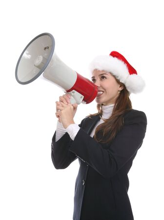 A pretty business woman using a megaphone at Christmas