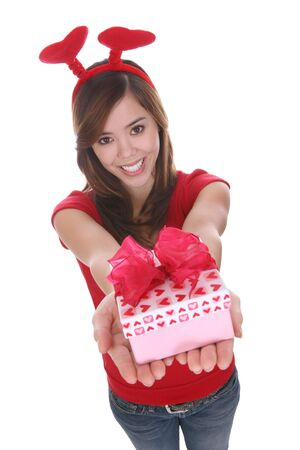 A pretty young woman giving a Valentines present Imagens