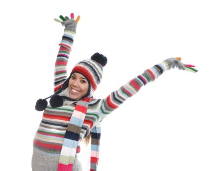 A cute girl in winter clothes over a white background