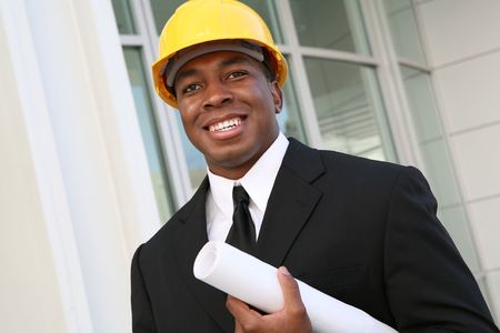 A young man working as an architect on a building site Stock Photo - 2370318
