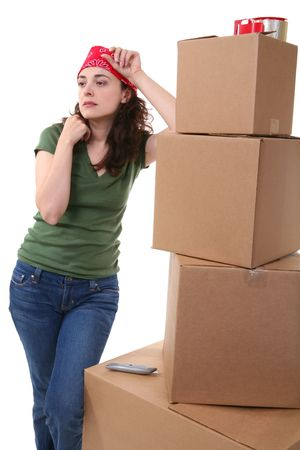 A pretty woman working with moving and shipping boxes Stock Photo - 2370350