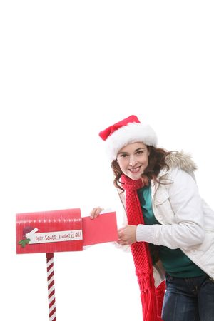 A pretty girl mailing her letter to santa claus at Christmas Stock Photo - 2370320