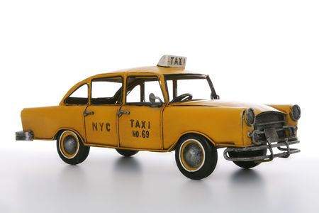 fare: An old vintage taxi cab over a white background