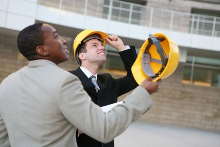 Hadsome men working as architects on a construction site Stock Photo - 2414892
