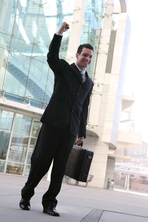 A business man celebrating success outside his office building Stock Photo - 2445207