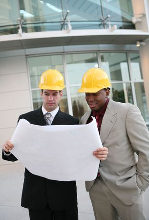 Handsome men working as  architects on a construction site Stock Photo - 2467424