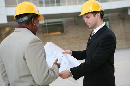 Handsome men working as  architects on a construction site Stock Photo - 2576988