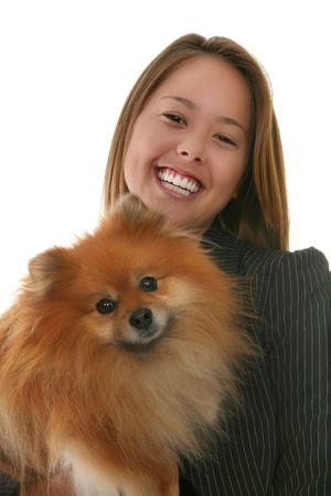 Pretty woman holding a cute, small Pomeranian dog Banco de Imagens