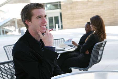 A handsome business man contemplating a big decision photo