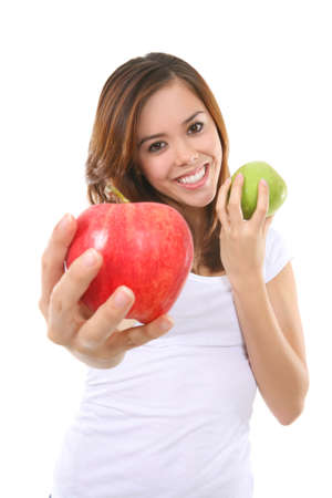 nourish: A pretty woman holding two colorful ripe apples