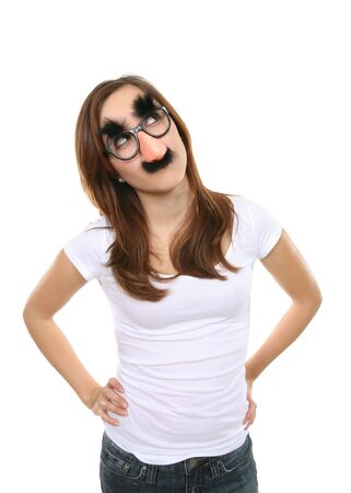 A pretty girl disguised with fake glasses, nose, and moustache photo