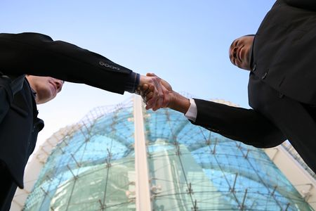 african business man: Two business men shaking hands in agreement Stock Photo