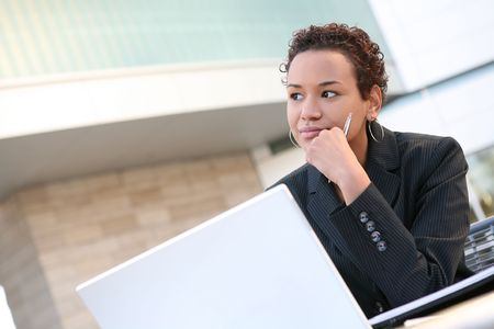 A pretty african american business woman on computer Stock Photo - 2557258
