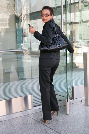 An african american business woman leaving work Stock Photo - 2562073