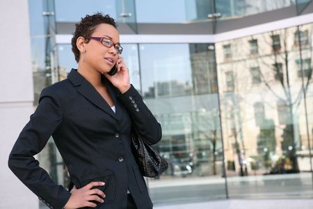 An african american business woman on the cell phone Stock Photo - 2586211