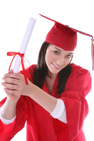 A pretty young woman at graduation holding her diploma