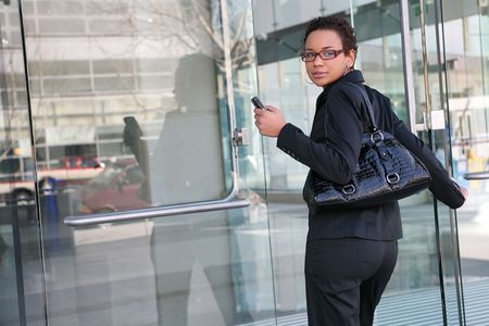 sexy business women: An african american business woman leaving work Stock Photo