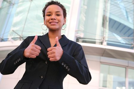 A pretty african american business woman with thumbs up Stock Photo - 2601182