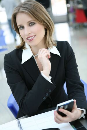 A beautiful business woman holding a electronic technology organizer  photo