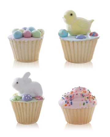 Colorful cute Easter cupcakes over a white background photo