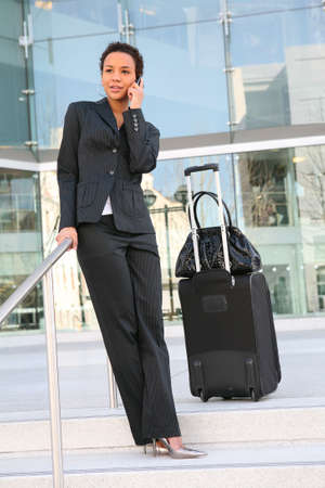 academia: A pretty african american business woman travelling Stock Photo