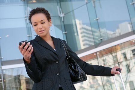 An african american business woman answering cell phone Stock Photo