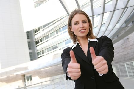 A pretty blonde business woman with her thumbs up Stock Photo - 2630648