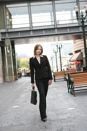 work: A pretty blonde business woman walking to work Stock Photo