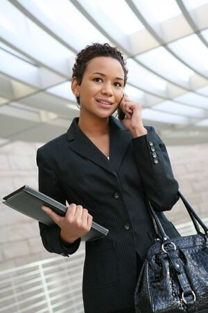 woman on phone: An african american business woman on the cell phone