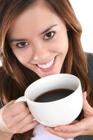 donna che beve il caff�: Una bella donna d'affari bere caff� da una tazza  Archivio Fotografico