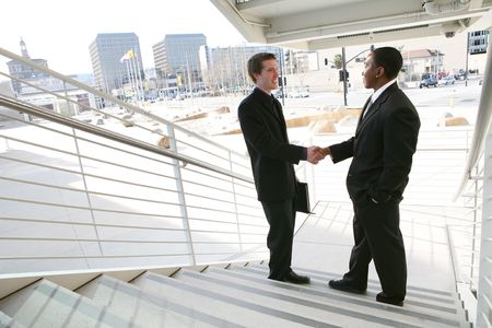 trust people: A business team shaking hands in agreement