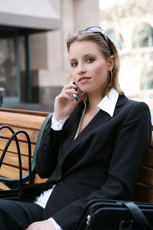A pretty business woman talking on her cell phone photo