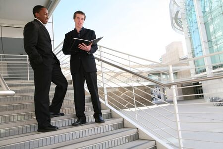 staircase structure: A diverse business man team walking down stairs