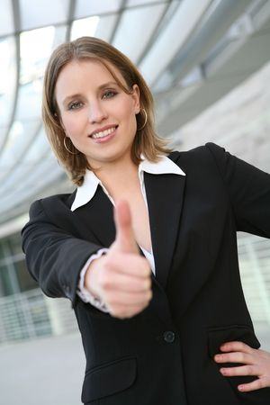 A pretty blonde business woman with her thumbs up Stock Photo - 2667717