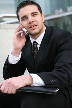 A handsome business man talking on the phone
