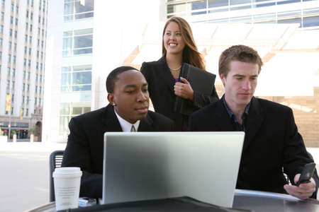 An attractive and diverse man and woman business team (Focus on woman) photo