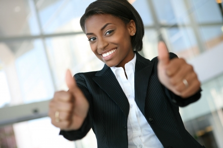 A pretty african american business woman with thumbs up photo