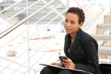 A pretty african american business woman at her company photo