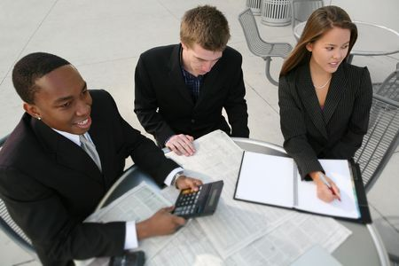 Attractive diverse business team working at table Stock Photo - 2712803