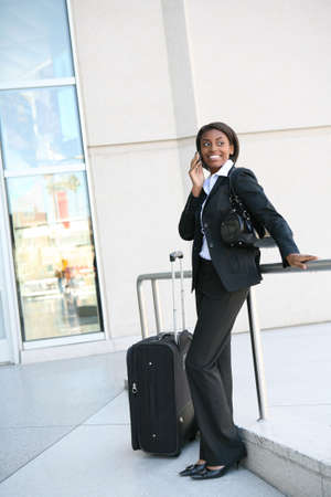 An pretty african american business woman on the cell phone Stock Photo - 2712800