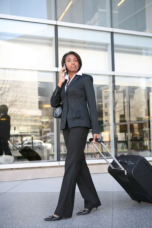 An pretty african american business woman travelling photo