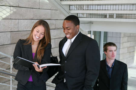 Attractive diverse business people at their company Stock Photo - 2712804
