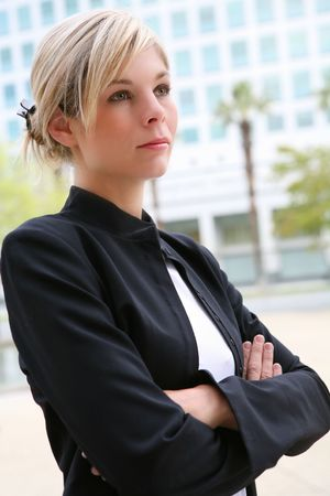 A pretty blonde business woman with arms crossed photo