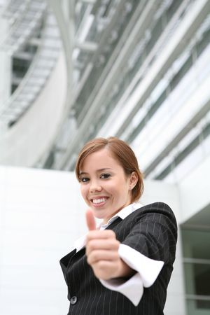 A pretty, young business woman with her thumb up Stock Photo - 2730335