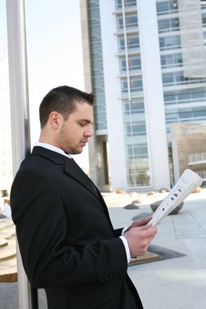 A handsome business man reading the newspaper  Stock Photo - 2775078