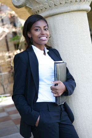 female lawyer: A pretty african american woman at college