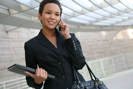 phone business: An african american business woman on the cell phone