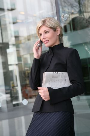 A beautiful blonde business woman on the phone photo