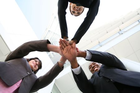 strong message: A diverse business team with hands together at company
